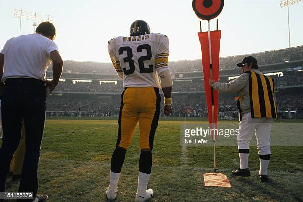 AFC Playoffs Rear view of Pittsburgh Steelers Franco Harris on sidelines next to chain crew member during game vs Oakland Raiders at OaklandAlameda...