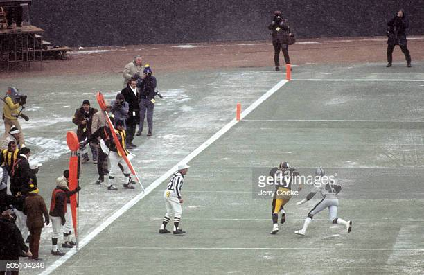 AFC Playoffs Rear view of Pittsburgh Steelers Franco Harris in action scoring touchdown vs Oakland Raiders Neal Colzie at Three Rivers Stadium...