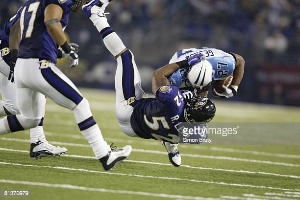 Football AFC Playoffs Tennessee Titans Eddie George in action during tackle by Baltimore Ravens Ray Lewis Baltimore MD 1/3/2004