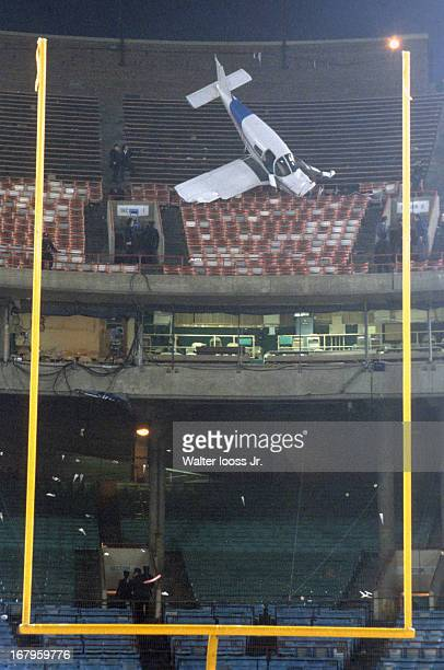 AFC Playoffs View of charter airplane in stands after crashing following Baltimore Colts vs Pittsburgh Steelers game at Memorial Stadium Baltimore MD...