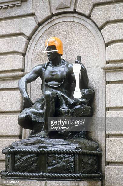 AFC Playoffs View of Energy in Repose statue by artist Henry Hering wearing Cleveland Browns helmet with bone in hand outside the Cleveland Federal...