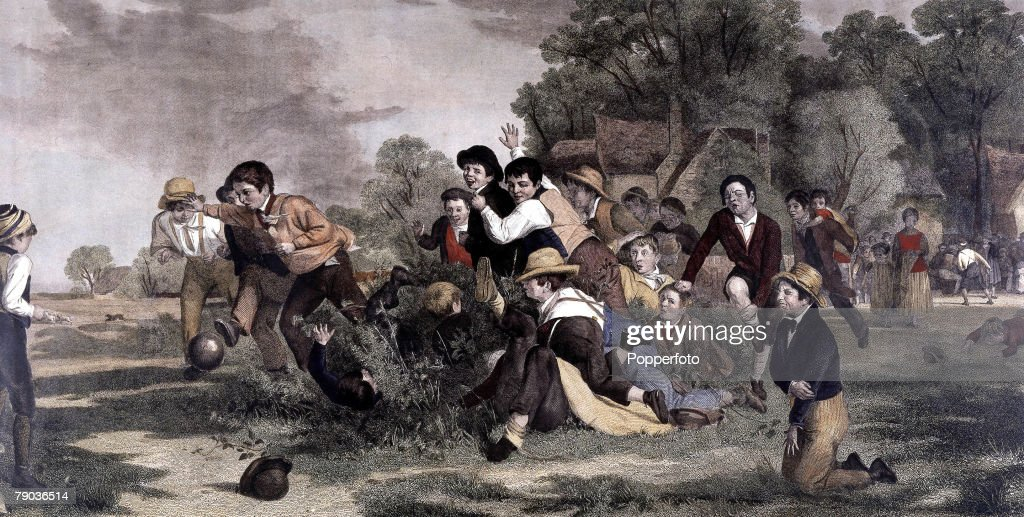 Football. After Thomas Webster R.A. (1800-1886). A hand coloured engraving depicting an historical village football game, published by the London Fine Art Association, 27th March 1877, by permission of Messers Brall and Sons. : News Photo