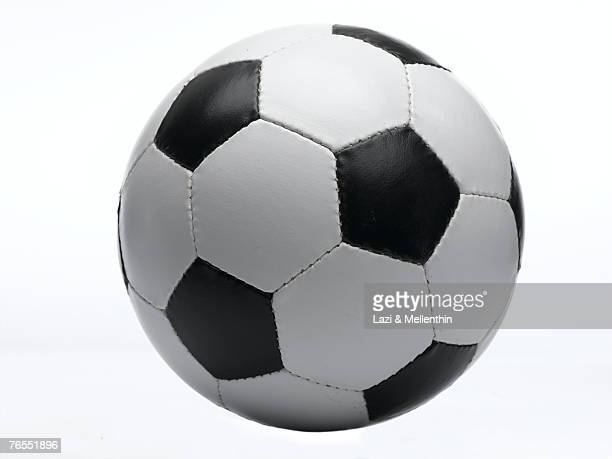 football against white background, close-up - palla sportiva foto e immagini stock