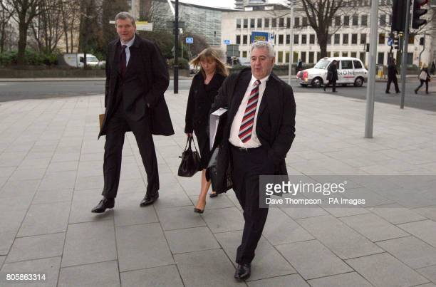 Football agent Paul Stretford and David Gill chief executive of Manchester United arrive at Manchester Civil Justice Centre for a court case where...