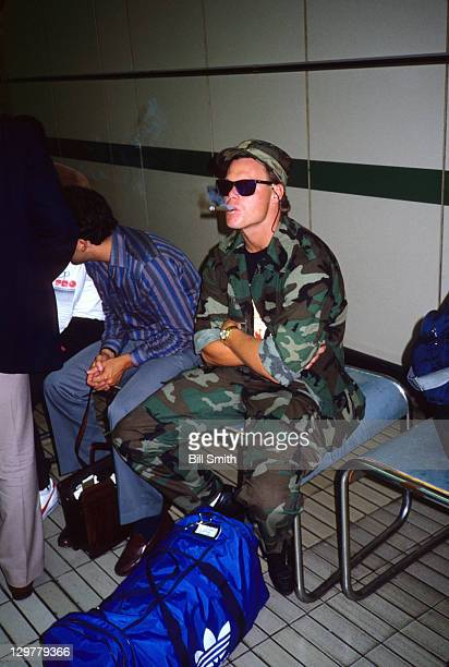 American Bowl Chicago Bears QB Jim McMahon wearing Camouflage and smoking cigar while sitting in customs at Heathrow Airport in Hillingdon London...