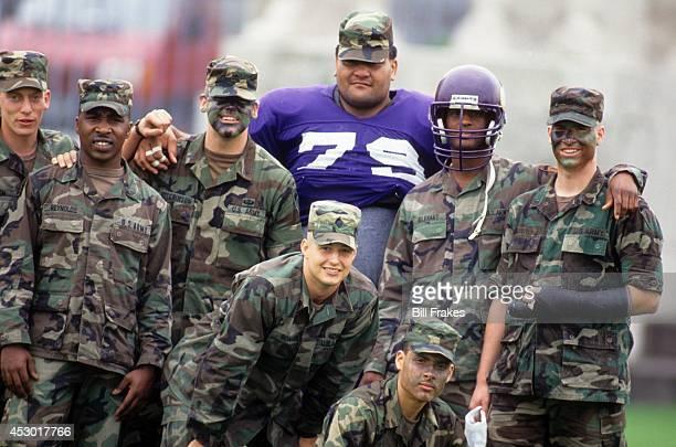 American Bowl US Army members posing with Minnesota Vikings Roosevelt Nix before game vs Buffalo Bills at Olympiastadion Berlin Germany 8/7/1993...