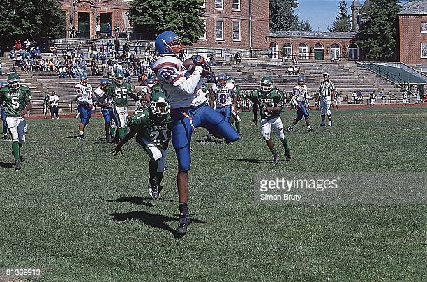 Football: Anacostia's Donnell Gray in action vs Woodrow Wilson's Davon Young , Washington, DC 9/15/2001