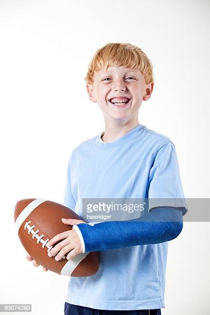 football and cast - cast colors for broken bones stock pictures, royalty-free photos & images