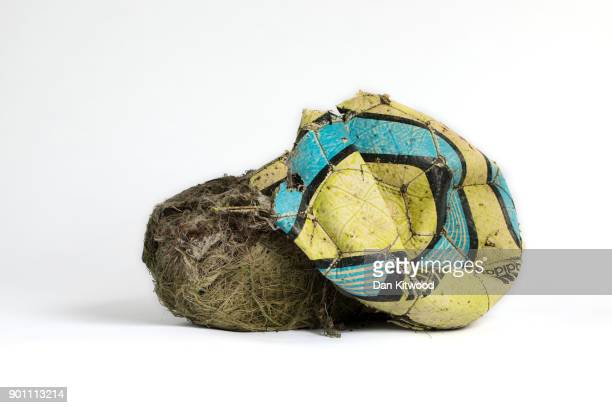 A football and it's stuffing found on the shore of the Thames Estuary on January 2 2018 in Rainham Kent Tons of plastic and other waste lines areas...