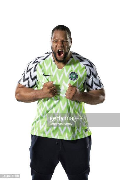 World Cup Preview Portrait of Los Angeles Rams defensive tackle Ndamukong Suh posing in Nigeria National Team soccer jersey during photo shoot at...