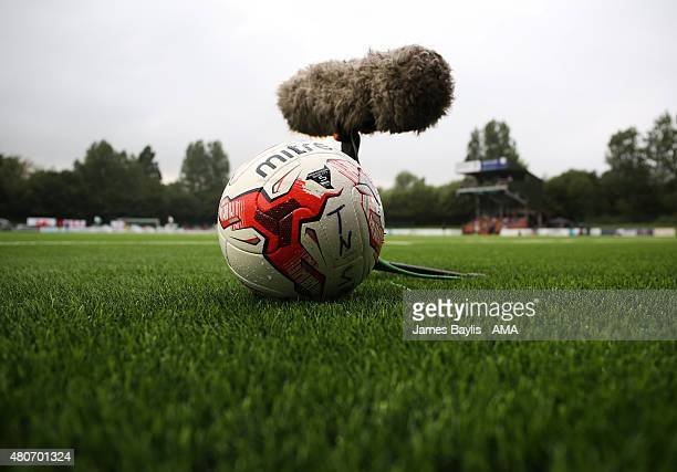 A football and TV microphone on the 3G artificial pitch at Park Hall Stadium home of The New Saints during the UEFA Champions League Qualifier...