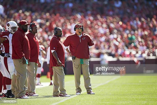 Arizona Cardinals head coach Bruce Arians with defensive coordinator Todd Bowles offensive coordinator Harold Goodwin and defensive line coach...