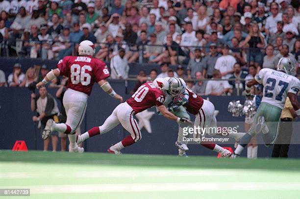 Football Arizona Cardinals Pat Tillman and Patrick Sapp in action making tackle vs Dallas Cowboys Deion Sanders Irving TX 10/3/1999