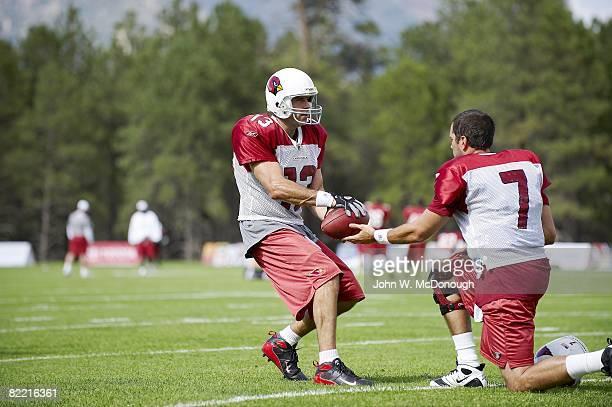 Arizona Cardinals QB Kurt Warner in action taking snap from QB Matt Leinart during training camp at Northern Arizona University Flagstaff AZ...