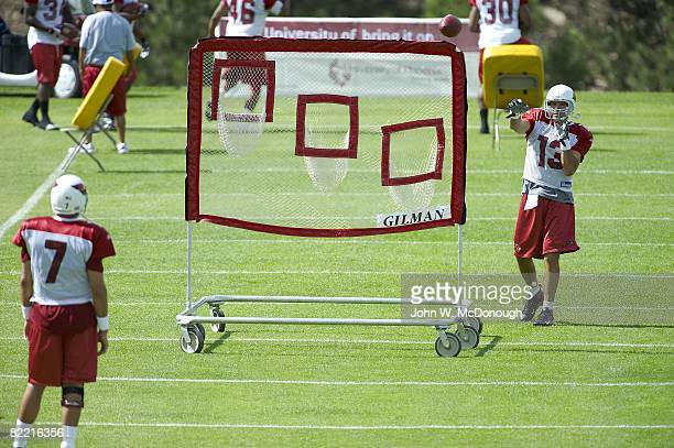 Arizona Cardinals QB Kurt Warner throwing ball into net while QB Matt Leinart watches during training camp at Northern Arizona University Flagstaff...
