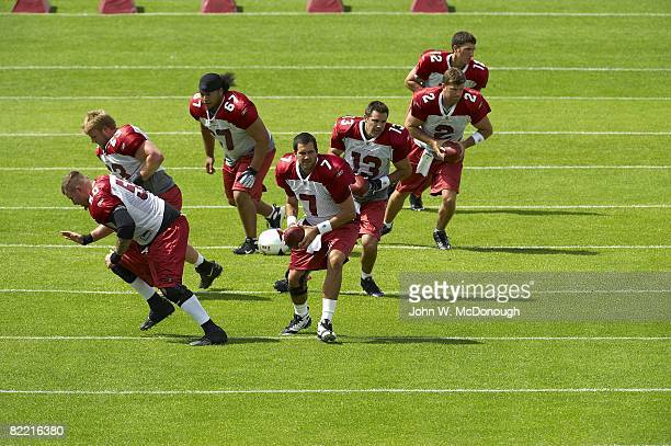 Arizona Cardinals QB Matt Leinart QB Kurt Warner Brian St Pierre and Anthony Morelli in action during training camp at Northern Arizona University...