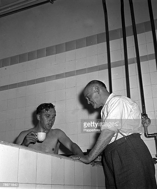 Football Arsenal Football Club Highbury London England Arsenal player Laurie Scott enjoys a cup of tea in the dressing room bath after their match...