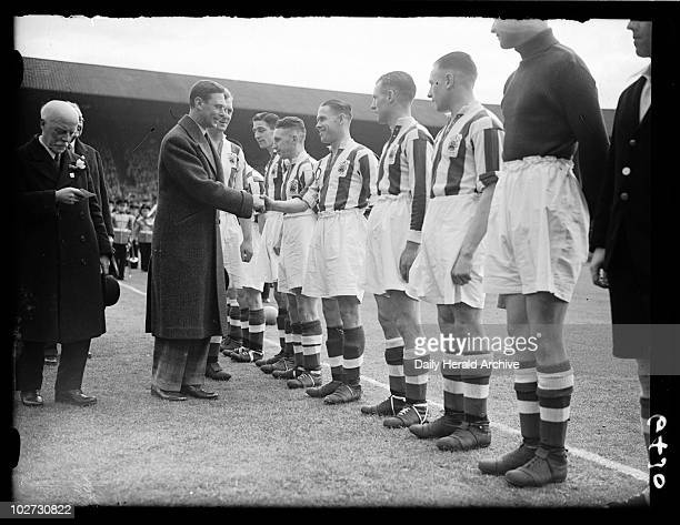 Football Association Cup Final 1938 A photograph of Huddersfield Town players lining up to shake George VI's hand before the start of the 1938 FA Cup...