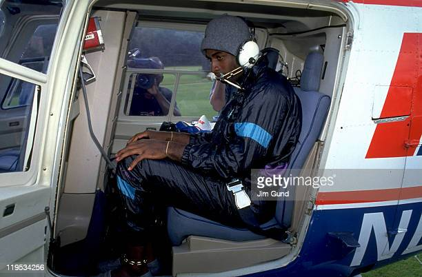 Atlanta Falcons Deion Sanders leaving practice for Atlanta Braves game aboard helicopter at Falcons Facility Suwanee GA CREDIT Jim Gund