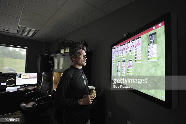 Atlanta Falcons general manager Thomas Dimitroff looks over depth chart during training camp at Falcons' Headquarters Complex Flowery Branch GA...