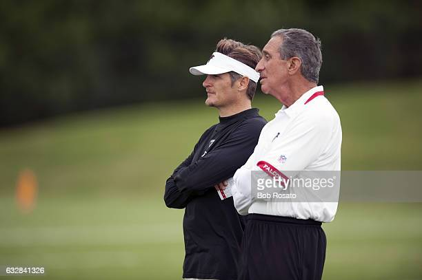 Atlanta Falcons owner and CEO Arthur Blank with general manager Thomas Dimitroff on field during training camp workout at Falcons Headquarters...