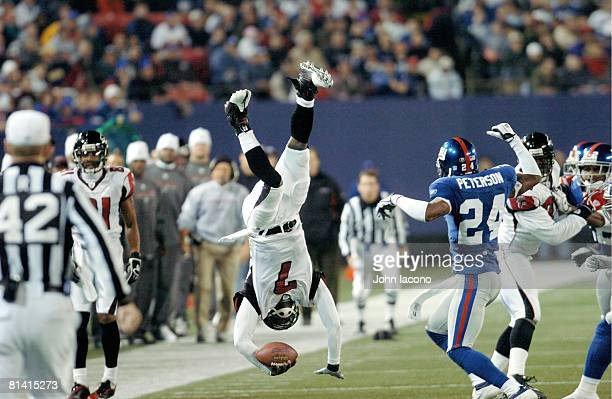 Football Atlanta Falcons QB Michael Vick in action getting upended vs New York Giants Will Peterson East Rutherford NJ