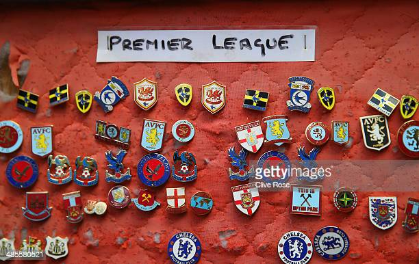 Football badges are sold on a street stall ahead of the Barclays Premier League match between Tottenham Hotspur and Fulham at White Hart Lane on...