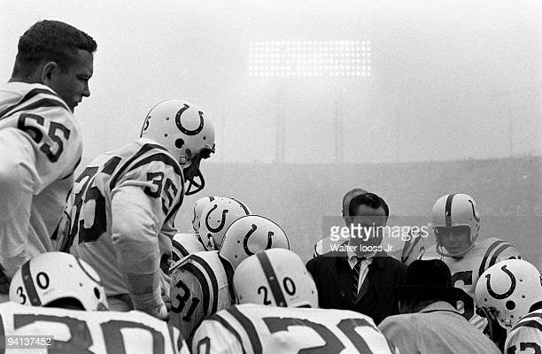 Baltimore Colts coach Don Shula in huddle with team during game vs Washington Redskins Baltimore MD CREDIT Walter Iooss Jr