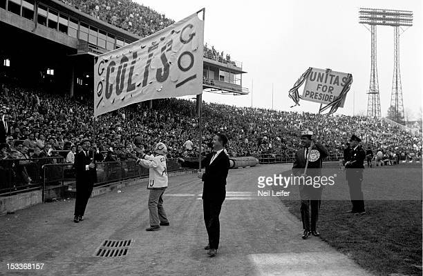 Baltimore Colts fans from Colts Corral supporters club holding GO COLTS GO and UNITAS FOR PRESIDENT signs during game vs San Francisco 49ers at...