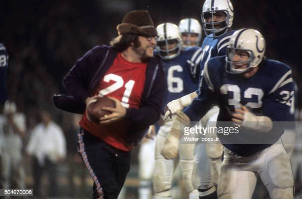 Baltimore Colts Mike Curtis about to tackle fan on field during game vs Miami Dolphins at Memorial Stadium Baltimore MD CREDIT Walter Iooss Jr