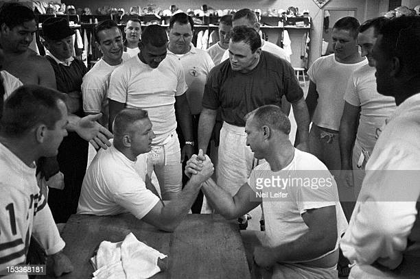 Baltimore Colts players casual arm wrestling before practice at Memorial Stadium Baltimore MD CREDIT Neil Leifer