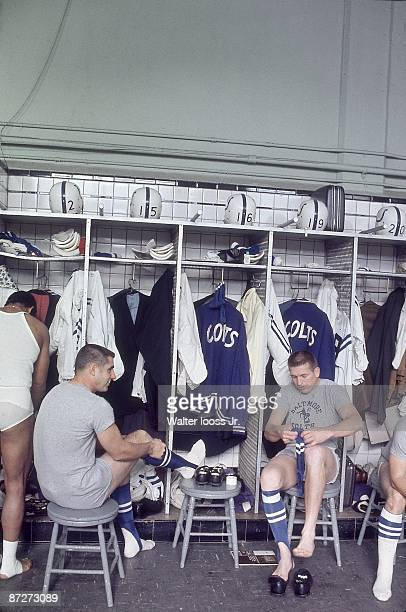 Baltimore Colts QB Earl Morrall and QB Johnny Unitas casual in locker room before game vs Detroit Lions Detroit MI CREDIT Walter Iooss Jr