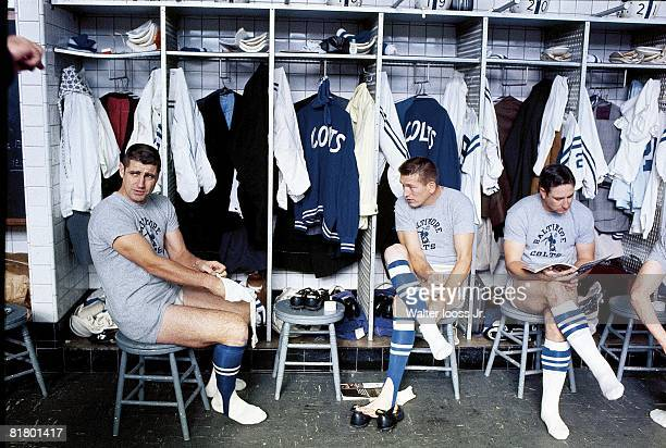 Football Baltimore Colts QB Earl Morrall QB Johnny Unitas and Jerry Logan casual in locker room before game vs Detroit Lions Detroit MI
