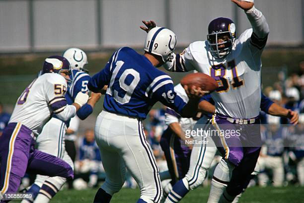 Football Baltimore Colts QB Johnny Unitas in action under pressure vs Minnesota Vikings Carl Eller at Metropolitan Stadium Bloomington MN 9/13/1964...