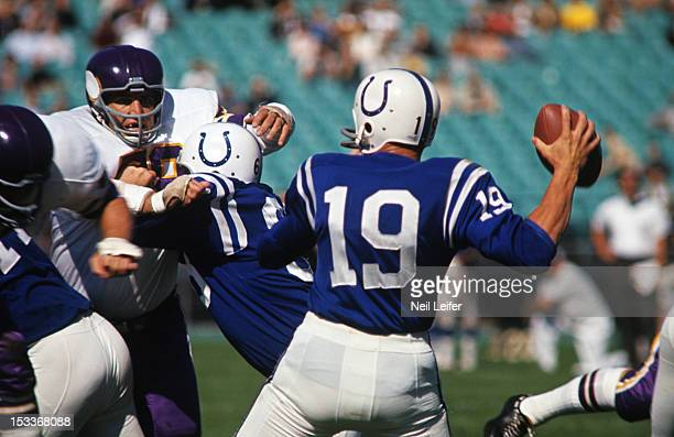 Baltimore Colts QB Johnny Unitas in action under pressure vs Minnesota Vikings at Metropolitan Stadium Bloomington MN CREDIT Neil Leifer