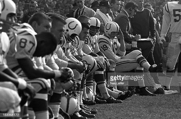 Baltimore Colts QB Johnny Unitas on sidelines bench during game vs Chicago Bears at Wrigley Field Chicago IL CREDIT Neil Leifer