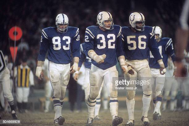 Baltimore Colts Ted Hendricks Mike Curtis and Ray May on field during game vs Miami Dolphins at Memorial Stadium Baltimore MD CREDIT Walter Iooss Jr