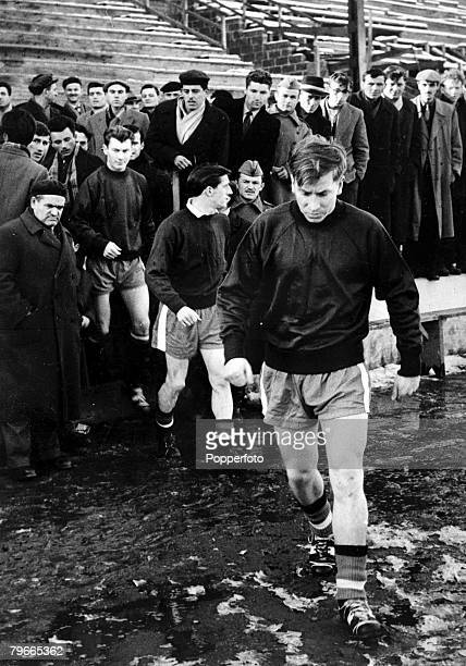 Football, Belgrade, Yugoslavia, 4th February Manchester United players led by Bobby Charlton run onto the pitch in the Yugoslav Army Stadium in...