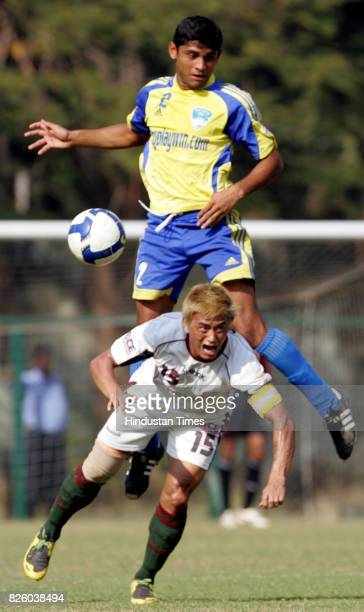 Football Bhaichung Bhutia of Mohun Bagan and Kamaljeet Kumar of Mumbai FC fights for the possession of the ball during their ILeague match at...
