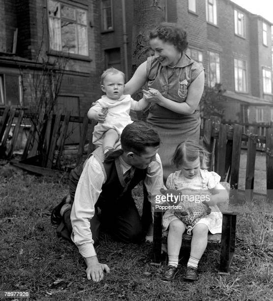 Football Bolton International centrehalf Malcolm Barrass born in BLackpool with his wife Joyce daughter Lynn and son Robert