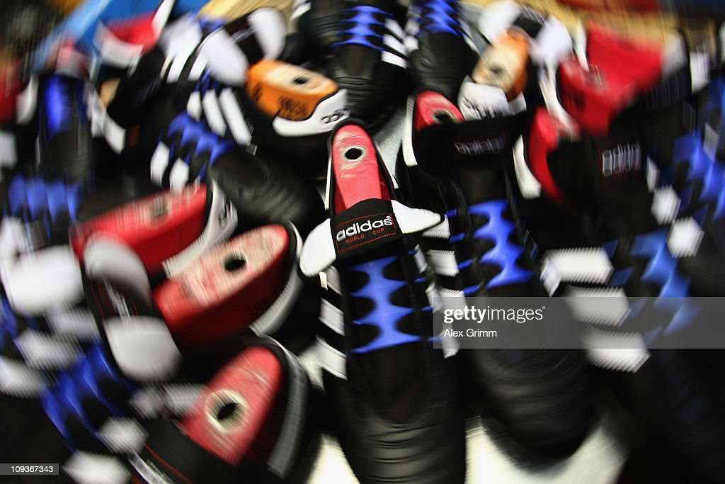 Football boots are seen during the production process at the factory of German sporting-goods maker Adidas AG on February 23, 2011 in Scheinfeld, Germany. The world's second biggest sports equipment and clothing maker, adidas, will present its 2010 result during a press conference on March 2, 2011.