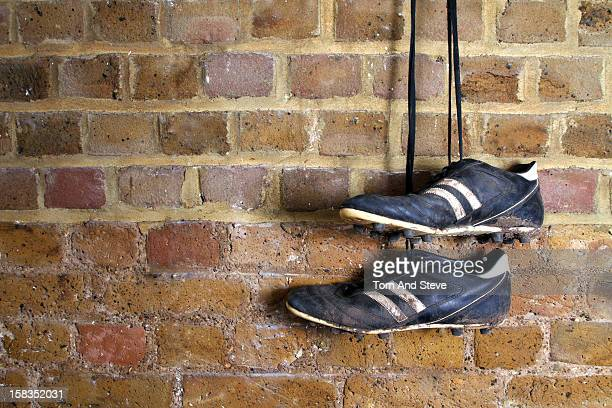 Football boots hanging on a changing room wall