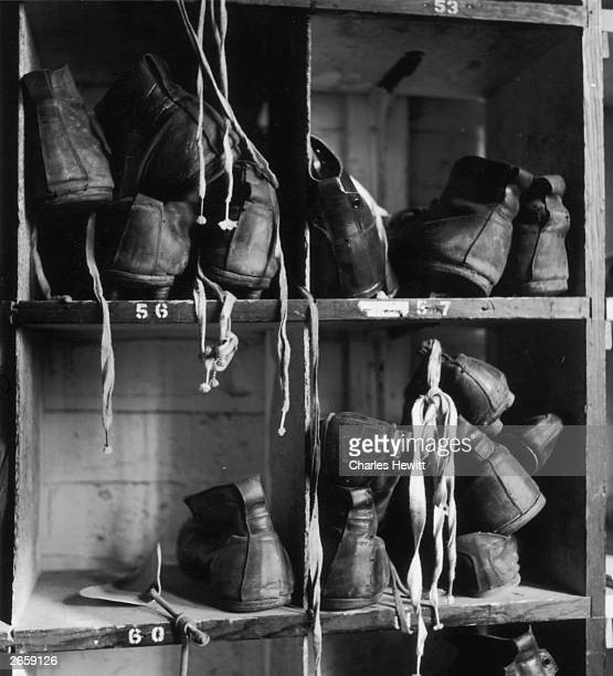 Football boots stacked in players' lockers at Wolverhampton Wanderers' ground Molyneux Original Publication Picture Post 6206 Catch 'Em Young pub 1952