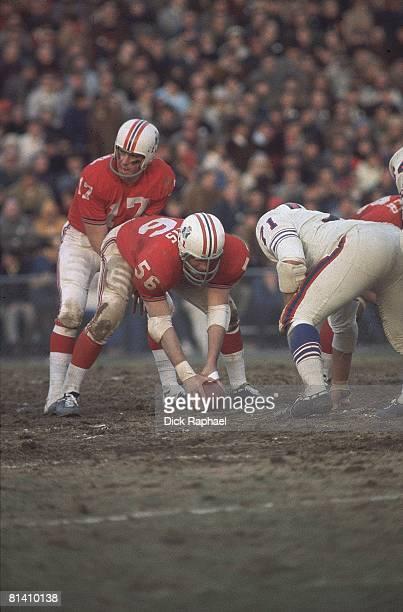 Boston Patriots Jon Morris before snap to QB Mike Taliaferro during game vs Buffalo Bills Chestnut Hill MA
