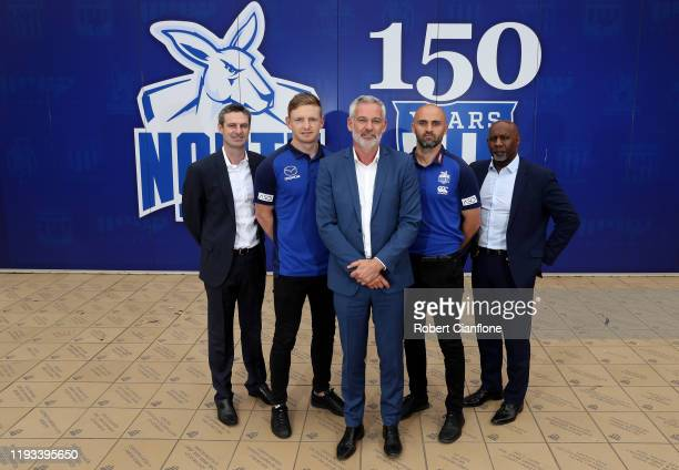 Football, Brady Rawlings, captain Jack Zeibell, North Melbourne chairman, Ben Buckley, coach Rhyce Shaw and CEO, Ben Amarfio pose during a North...