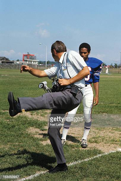Buffalo Bills OJ Simpson being instructed on pose by photographer during training camp at Niagara University Lewiston NY CREDIT Neil Leifer
