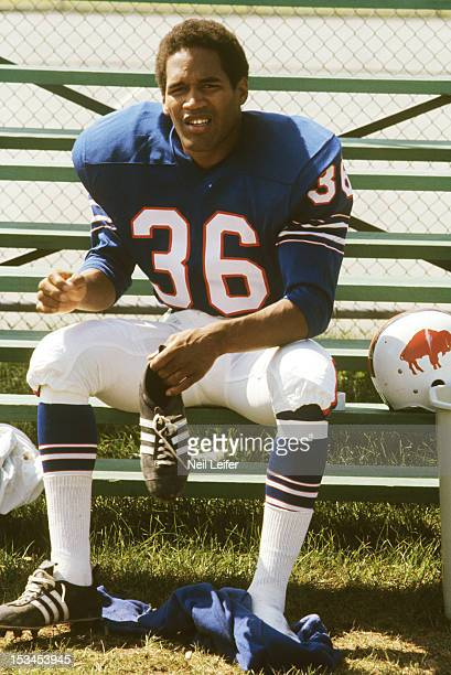Buffalo Bills OJ Simpson putting cleats on during training camp at Niagara University Lewiston NY CREDIT Neil Leifer