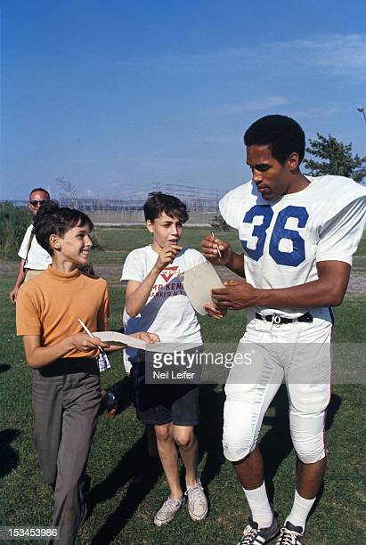 Buffalo Bills OJ Simpson signing autographs for fans during training camp at Niagara University Lewiston NY CREDIT Neil Leifer