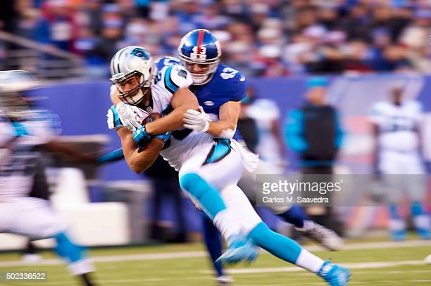 Carolina Panthers Greg Olsen in action vs New York Giants Craig Dahl at MetLife Stadium East Rutherford NJ CREDIT Carlos M Saavedra
