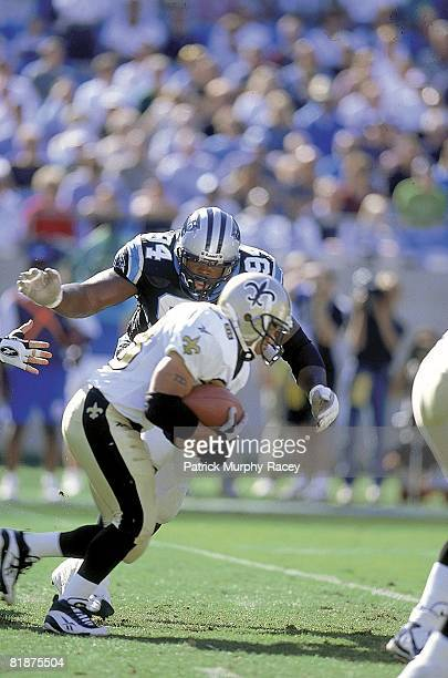 Football: Carolina Panthers Sean Gilbert in action, making tackle vs New Orleans Saints, Charlotte, NC 11/1/1998